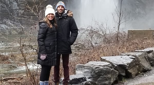 Amy, a former patient of Dr. Jay Granzow, MD, stands with a friend in front of a waterfall.