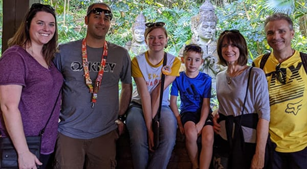 Lori, a former patient of Dr. Jay Granzow, MD, with her family on vacation in an Asian country.