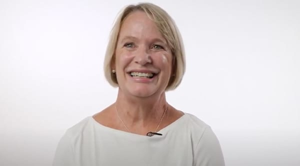 Shelly, a former patient of Dr. Jay Granzow, MD, with a big smile on her face.