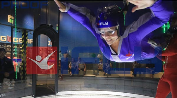 Keli, a former patient of Dr. Jay Granzow, MD, performs indoor skydiving.