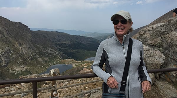 Bonnie, a former patient of Dr. Jay Granzow, MD, smiles while at a nature overlook.